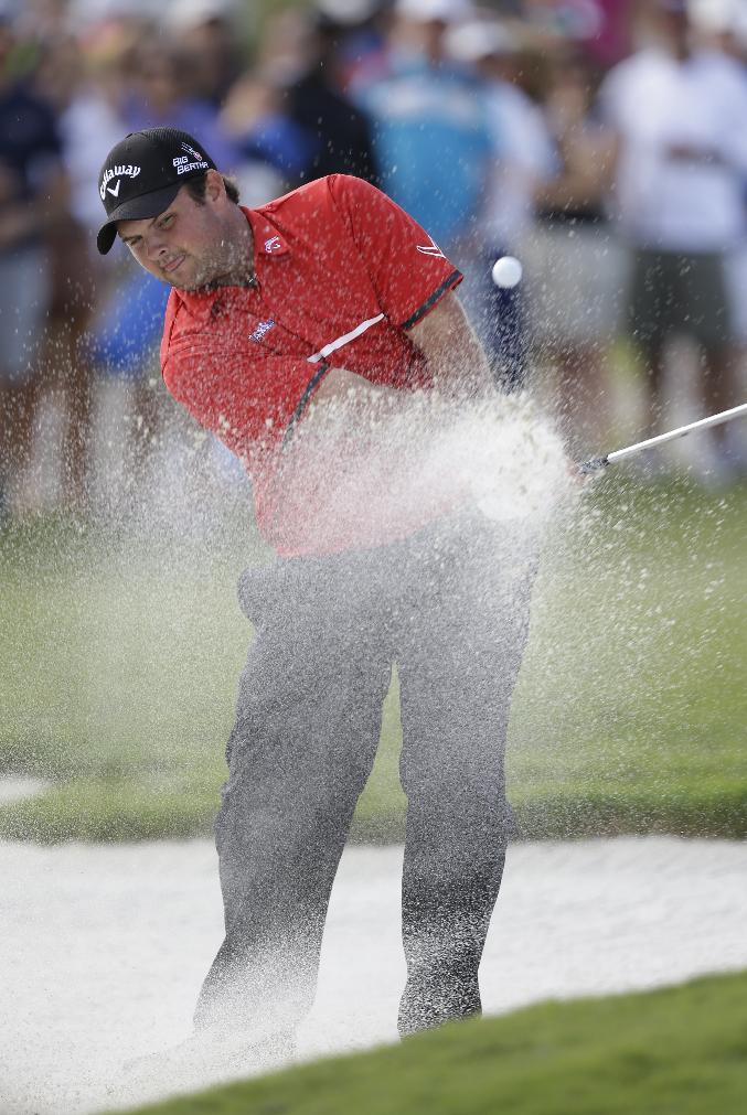 Patrick Reed hits from an eighth hole sand trap during the final round of the Cadillac Championship golf tournament on Sunday, March 9, 2014, in Doral, Fla. (AP Photo/Wilfredo Lee)