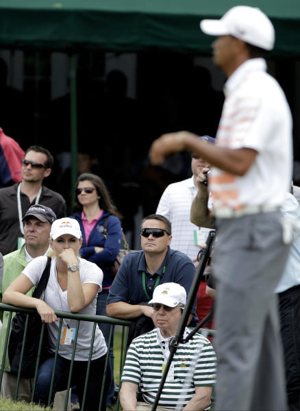 Lindsey Vonn, left, watches Tiger Woods on the 18th green during the second round of the U.S. Open golf tournament at Merion Golf Club, Friday, June 14, 2013, in Ardmore, Pa. (AP Photo/Charlie Riedel)