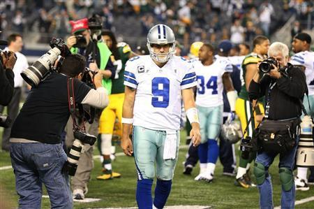 Dec 15, 2013; Arlington, TX, USA; Dallas Cowboys quarterback Tony Romo (9) walks off the field as photographers capture images after the game against the Green Bay Packers at AT&T Stadium. Matthew Emmons-USA TODAY Sports