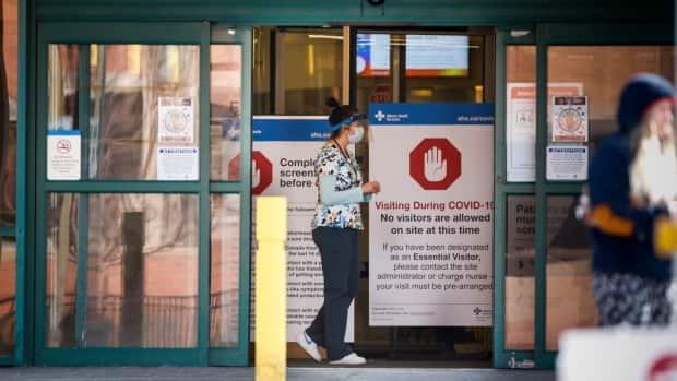 As of Sunday, Alberta's rate of infection was 1.48, higher than in spring when more than 1,500 cases were reported daily. (Jeff McIntosh/The Canadian Press - image credit)