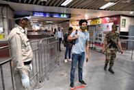 Commuters arrive at a metro station after Delhi Metro Rail Corporation (DMRC) resumed services in New Delhi on September 7, 2020. (Photo by PRAKASH SINGH/AFP via Getty Images)