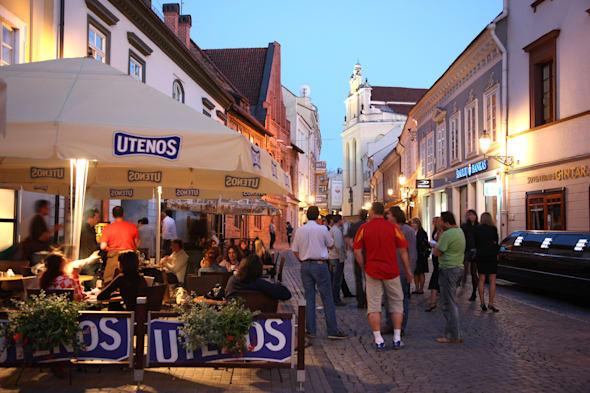 LTU Lithuania Capital Vilnius Oldtown Pilies street with restaurants and bars at night
