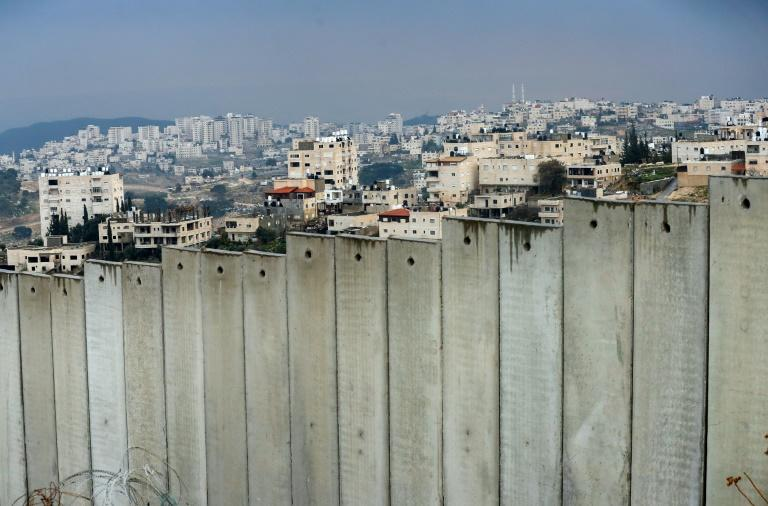 The occupied West Bank village of al-Eizariya lies behind Israel's controversial separation barrier on the outskirts of East Jerusalem