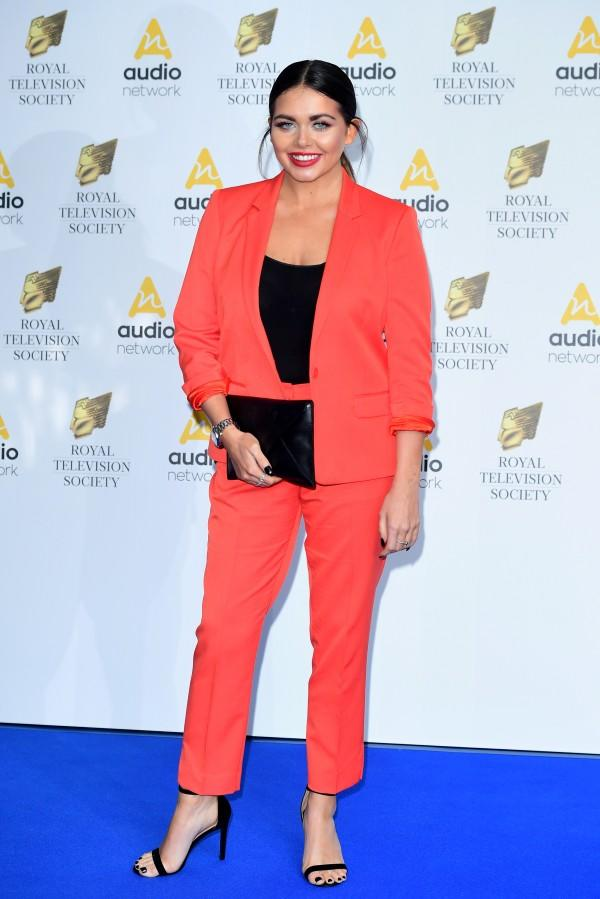 Scarlett elevated her style game once again in an unmissable orange suit.<br /><i>[Photo: PA]</i>
