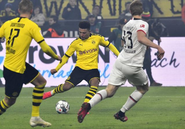 Dortmund's Jadon Sancho scores his side's second goal during the German Bundesliga soccer match between Borussia Dortmund and Eintracht Frankfurt in Dortmund, Germany, Friday, Feb. 14, 2020. (AP Photo/Martin Meissner)