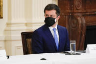 Secretary of Transportation Secretary Pete Buttigieg attends a Cabinet meeting with President Joe Biden in the East Room of the White House, Thursday, April 1, 2021, in Washington. (AP Photo/Evan Vucci)