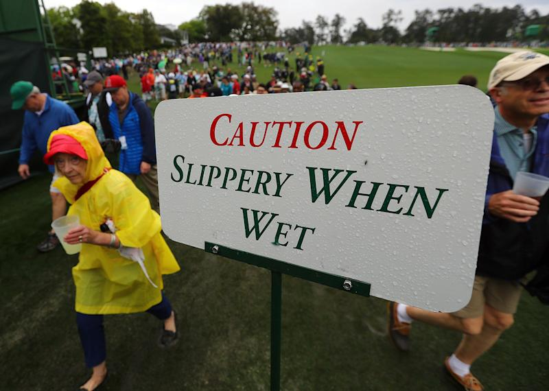 Golf patrons evacuate the course along the first fairway as a weather warning closes the morning practice round for the Masters golf tournament at Augusta National Golf Club in Augusta, Ga., Tuesday, April 9, 2019. (Curtis Compton/Atlanta Journal-Constitution via AP)