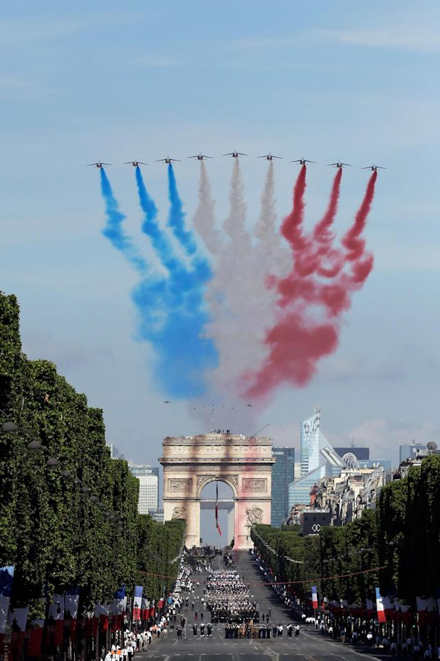 <p>French Alphajets of the Patrouille de France fly over the Champs Elysees avenue, with the Arc de Triomphe in background, during the Bastille Day parade in Paris, Friday, July 14, 2017. (Photo: Markus Schreiber/AP) </p>