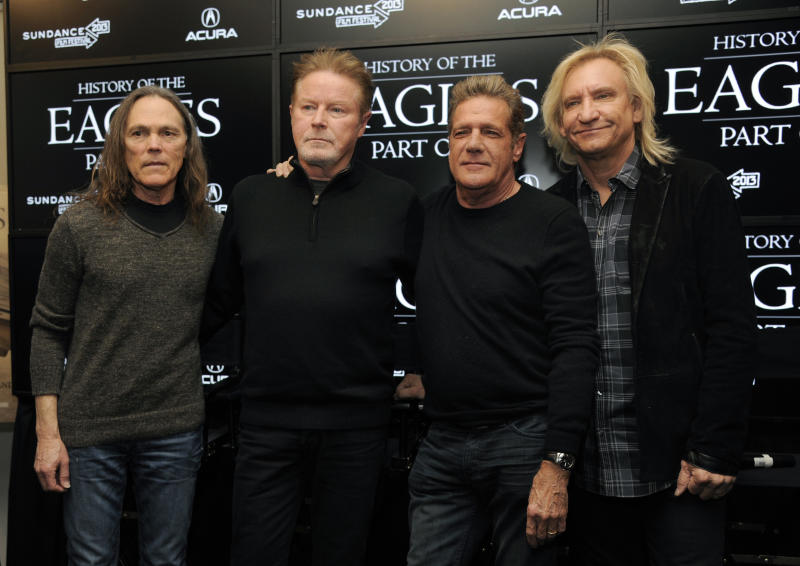 "From left, Timothy B. Schmit, Don Henley, Glenn Frey and Joe Walsh of The Eagles pose together after a news conference at the 2013 Sundance Film Festival, Saturday, Jan. 19, 2013, in Park City, Utah. The documentary film ""The History of The Eagles Part 1"" is being shown at the festival. (Photo by Chris Pizzello/Invision/AP)"