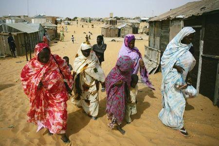 Mauritanians ex-slaves walk in a suburb outside Mauritania's capital Nouakchott in a file photo.    REUTERS/Rafael Marchante