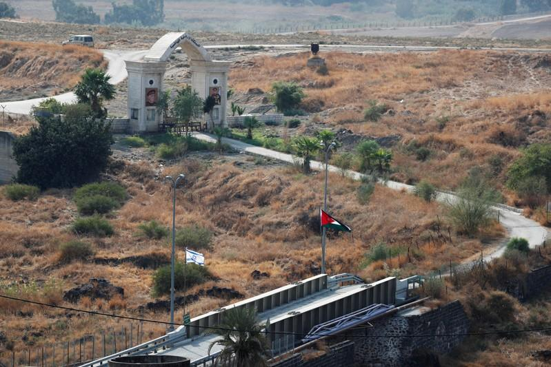 The national flags of Israel and Jordan are seen in an area known as Naharayim in Hebrew and Baquora in Arabic, in the border area between Israel and Jordan, as seen from the Israeli side