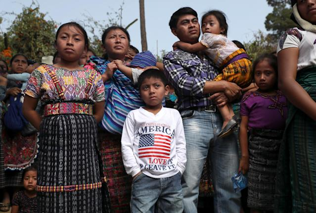 <p>Families attend a memorial service for two boys who were kidnapped and killed on Feb. 14, 2017, in San Juan Sacatepequez, Guatemala. More than 2,000 people walked in a funeral procession for Oscar Armando Top Cotzajay, 11, and Carlos Daniel Xiqin, 10, who were abducted while walking to school. Residents found the boys stuffed in sacks, with their throats slashed and hands and feet bound. Neighbors reported a ransom demand was made. Such crimes have driven emigration from Guatemala to the U.S. as families seek refuge from the violence. (Photo: John Moore/Getty Images) </p>