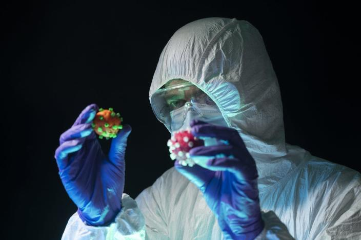 "<span class=""caption"">The SARS-CoV-2 virus is mutating.</span> <span class=""attribution""><a class=""link rapid-noclick-resp"" href=""https://www.gettyimages.com/detail/photo/scientist-in-a-protective-suit-holds-and-compares-royalty-free-image/1285458686?adppopup=true"" rel=""nofollow noopener"" target=""_blank"" data-ylk=""slk:Aitor Diago/Moment via Getty Images"">Aitor Diago/Moment via Getty Images</a></span>"