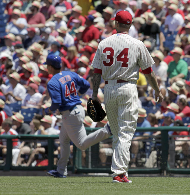 Philadelphia Phillies starting pitcher A.J. Burnett (34) watches Chicago Cubs' Anthony Rizzo (44) run the bases afterRizzo hit a solo home run in the first inning of a baseball game on Sunday, June 15, 2014, in Philadelphia. (AP Photo/H. Rumph Jr)