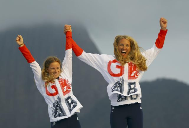 2016 Rio Olympics - Sailing - Victory Ceremony - Women's Two Person Dinghy - 470 - Victory Ceremony - Marina de Gloria - Rio de Janeiro, Brazil - 18/08/2016. Gold medalists Hannah Mills (GBR) of Britain and Saskia Clark (GBR) of Britain celebrate. REUTERS/Brian Snyder FOR EDITORIAL USE ONLY. NOT FOR SALE FOR MARKETING OR ADVERTISING CAMPAIGNS.