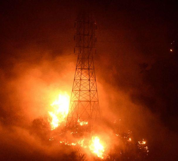 PHOTO: Heavy fire from the Thomas Fire burns around power line towers in Coyote Canyon near Montecito, Calif., Dec. 16, 2017. (Gene Blevins/Reuters)