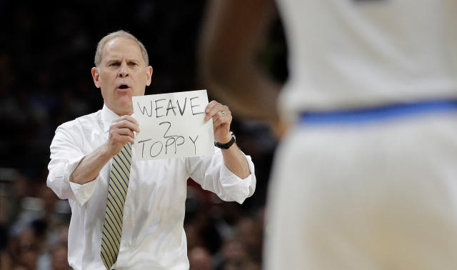 Michigan head coach John Beilein directs his team during the first half in the championship game of the Final Four NCAA college basketball tournament against Villanova, Monday, April 2, 2018, in San Antonio. (AP Photo/David J. Phillip)