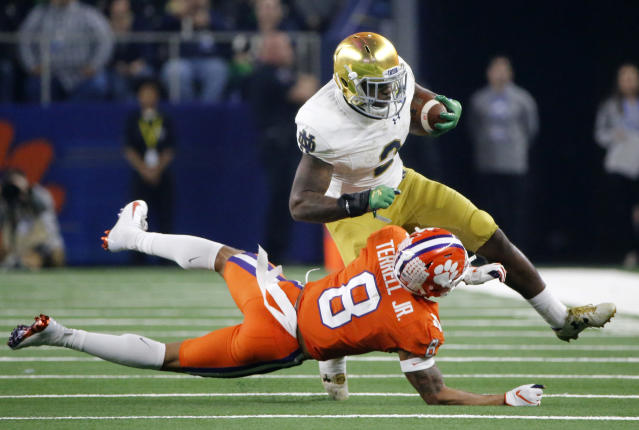 Clemson cornerback A.J. Terrell (8) attempts to stop Notre Dame running back Dexter Williams (2) after a short run in the second half of the NCAA Cotton Bowl semi-final playoff football game, Saturday, Dec. 29, 2018, in Arlington, Texas. (AP Photo/Michael Ainsworth)