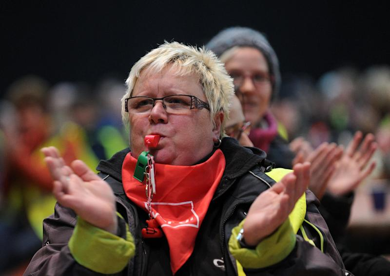 An Amazon employee blows a whistle during a strike action at Amazon's logistics center in Bad Hersfeld, central Germany, Monday, Sept. 25, 2013. Hundreds of Amazon.com Inc. workers stage a strike in Germany and the union says there will be more to come in the run-up to Christmas unless the online retailer raises wages. The one-day warning strike Monday at Amazon's distribution centers in Bad Hersfeld and Leipzig were the latest of several as the ver.di union pushes for wage agreements similar to those governing retail and mail-order workers. (AP Photo/dpa, Uwe Zucchi)