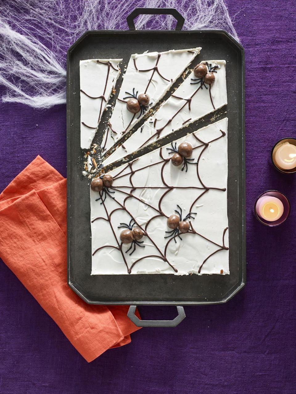 """<p>Chocoholics will go crazy for this pretzel web covered in white chocolate, drizzled with semi-sweet chocolate, and decorated with chocolate malt-ball spiders.</p><p><em><strong><a href=""""https://www.womansday.com/food-recipes/food-drinks/recipes/a60166/candy-cobwebs-recipe/"""" rel=""""nofollow noopener"""" target=""""_blank"""" data-ylk=""""slk:Get the Candy Cobwebs recipe."""" class=""""link rapid-noclick-resp"""">Get the Candy Cobwebs recipe.</a></strong></em></p>"""