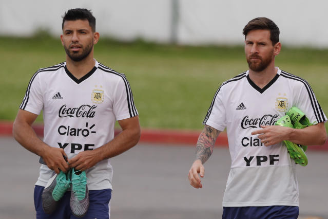 Lionel Messi, right, and Sergio Aguero arrive for a training session of Argentina at the 2018 soccer World Cup in Bronnitsy, Russia, Tuesday, June 19, 2018. (AP Photo/Ricardo Mazalan)