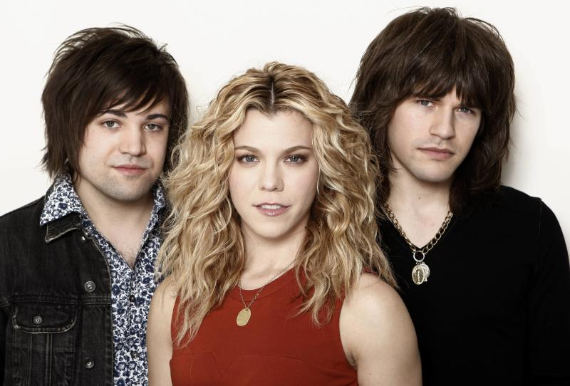 """This Jan. 23, 2013, photo shows musicians Kimberly Perry, center, Neil Perry, left, and Reid Perry, from The Band Perry in Los Angeles. The band released its sophomore album """"Pioneer"""" in April.  (Photo by Matt Sayles/Invision/AP)"""