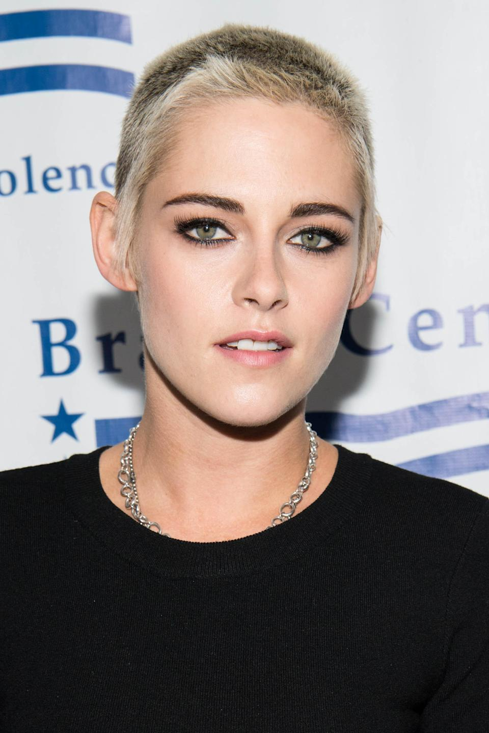 "Stewart's <a href=""https://www.glamour.com/story/kristen-stewart-has-frosted-tips?mbid=synd_yahoo_rss"" rel=""nofollow noopener"" target=""_blank"" data-ylk=""slk:bright blonde and frosted tips"" class=""link rapid-noclick-resp"">bright blonde and frosted tips</a> contrasts with her typically dark style in the coolest way."