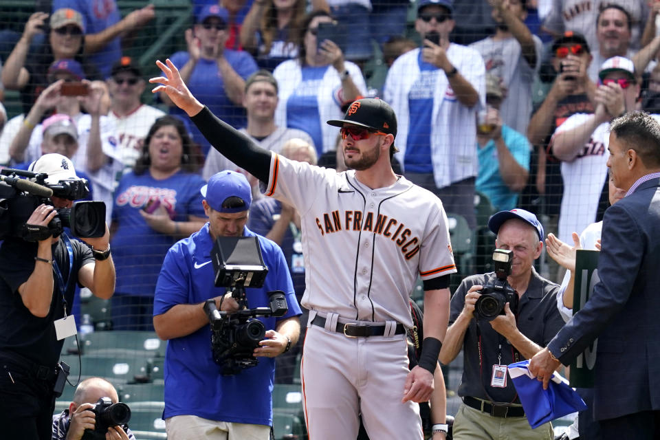 San Francisco Giants' Kris Bryant greets Chicago Cubs fans before a baseball game in Chicago, Friday, Sept. 10, 2021. (AP Photo/Nam Y. Huh)
