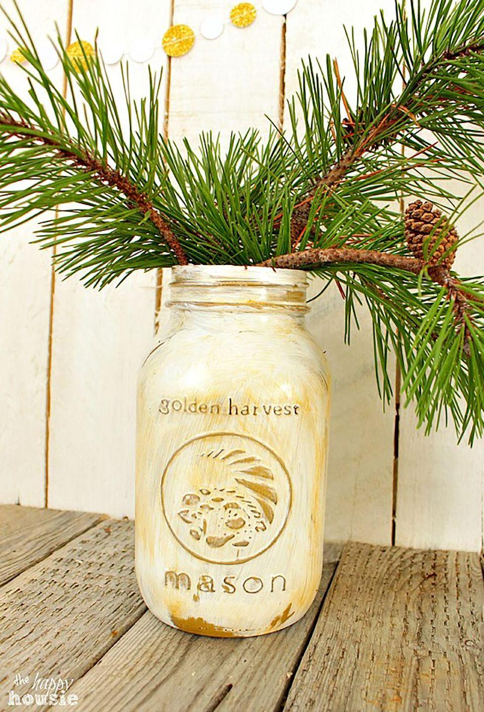 """<p>Use gold spray-paint, gold wax, and white Chalk Paint on your Mason jars to create a shining centerpiece you can use year after year. </p><p><strong>Get the tutorial at <a href=""""http://thehappyhousie.com/distressed-white-gold-mason-jars-for-your-holiday-table/"""" rel=""""nofollow noopener"""" target=""""_blank"""" data-ylk=""""slk:The Happy Housie"""" class=""""link rapid-noclick-resp"""">The Happy Housie</a>.</strong></p><p><a class=""""link rapid-noclick-resp"""" href=""""https://www.amazon.com/Krylon-KSCS029-Short-Aerosol-Spray/dp/B000GLHVIC/?tag=syn-yahoo-20&ascsubtag=%5Bartid%7C10050.g.2132%5Bsrc%7Cyahoo-us"""" rel=""""nofollow noopener"""" target=""""_blank"""" data-ylk=""""slk:SHOP GOLD SPRAY PAINT"""">SHOP GOLD SPRAY PAINT</a></p>"""