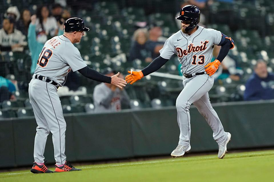 Detroit Tigers' Eric Haase (13) is greeted by third base coach Chip Hale after Haase hit a solo home run during the second inning of a baseball game against the Seattle Mariners, Monday, May 17, 2021.