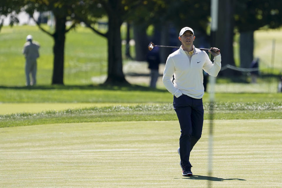 Rory McIlroy, of Northern Ireland, checks his lie on the first green during the third round of the US Open Golf Championship, Saturday, Sept. 19, 2020, in Mamaroneck, N.Y. (AP Photo/John Minchillo)