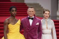 Lashana Lynch, from left, Daniel Craig and Lea Seydoux pose for photographers upon arrival for the World premiere of the new film from the James Bond franchise 'No Time To Die', in London Tuesday, Sept. 28, 2021. (AP Photo/Matt Dunham)