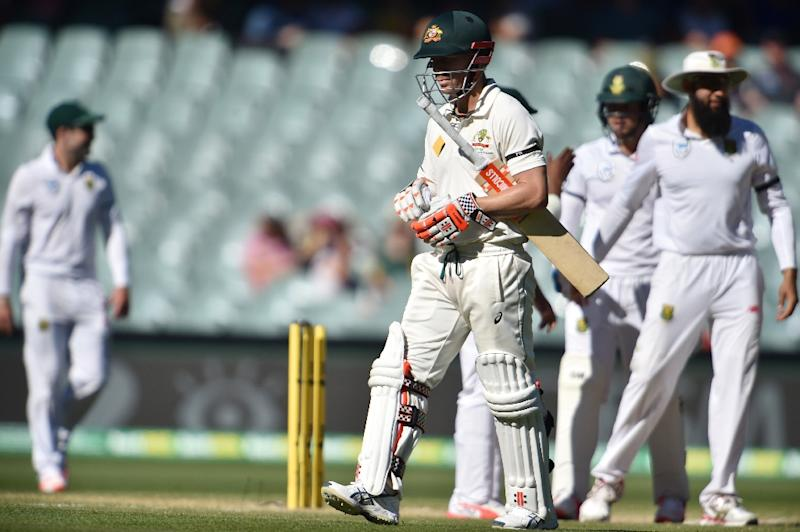 Australia's David Warner walks after being dismissed by South Africa on the fourth day of the third Test match in Adelaide on November 27, 2016 (AFP Photo/Peter Parks)