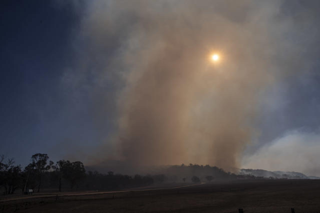 Fire burns on Bolivia Hill near Glen Innes on November 10, 2019 in Glen Innes, Australia. Three people are confirmed dead with the death toll expected to rise and more than 150 homes have been destroyed as bushfires continue to burn across eastern Australia. Two people died in the fire in the Kangawalla area, near Glen Innes on the New South Wales north coast. Another body was found in a burnt out house in the township of Johns River, north of Taree on Saturday. Drought-like conditions across Northern NSW and Queensland coupled with hot weather and winds have hampered efforts to bring more than 80 fires under control. Four fires (two in NSW and two in QLD) are at emergency level, while a state of emergency has been declared across parts of Queensland. (Photo by Brook Mitchell/Getty Images)