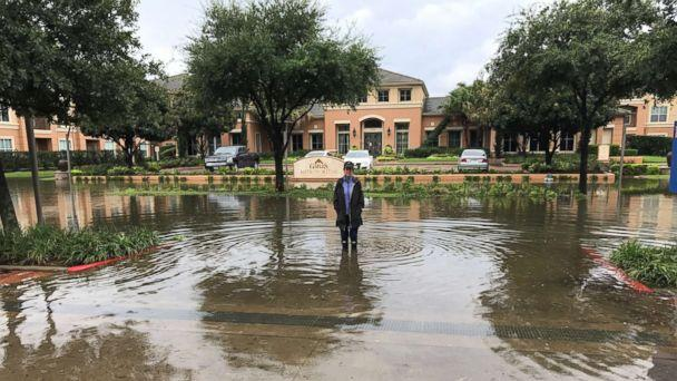PHOTO: Freelance journalist Karen D'Uva stands in floodwaters from Hurricane Harvey outside the