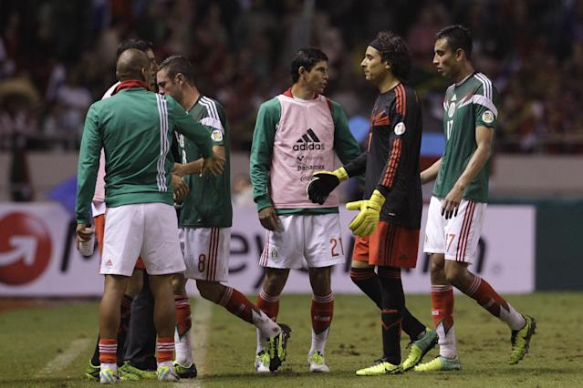 Mexico's players leave the field after losing against Costa Rica during a 2014 World Cup qualifying soccer match in San Jose, Costa Rica, Tuesday, Oct. 15, 2013. (AP Photo/Moises Castillo)