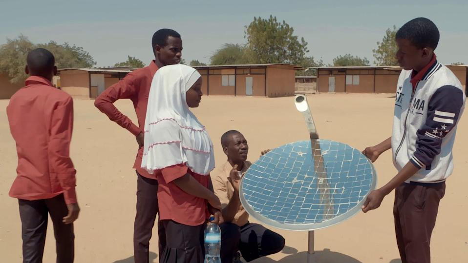 School teacher Omar shows his pupils how to set up a solar cell for power (BBC / Inside Out Films/ LemKino Pix)