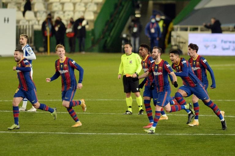 Barcelona celebrate their penalty shootout win over Real Sociedad in the semi-finals of the Spanish Super Cup