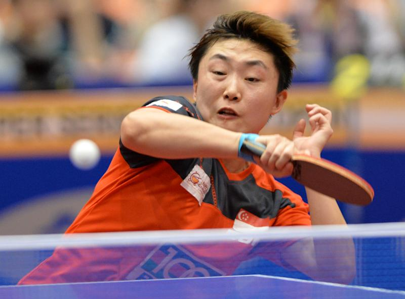 Singapore's Feng Tianwei hits a return against Japan's Kasumi Ishikawa during the final at the Japan Open table tennis tournament in Yokohama on June 22, 2014
