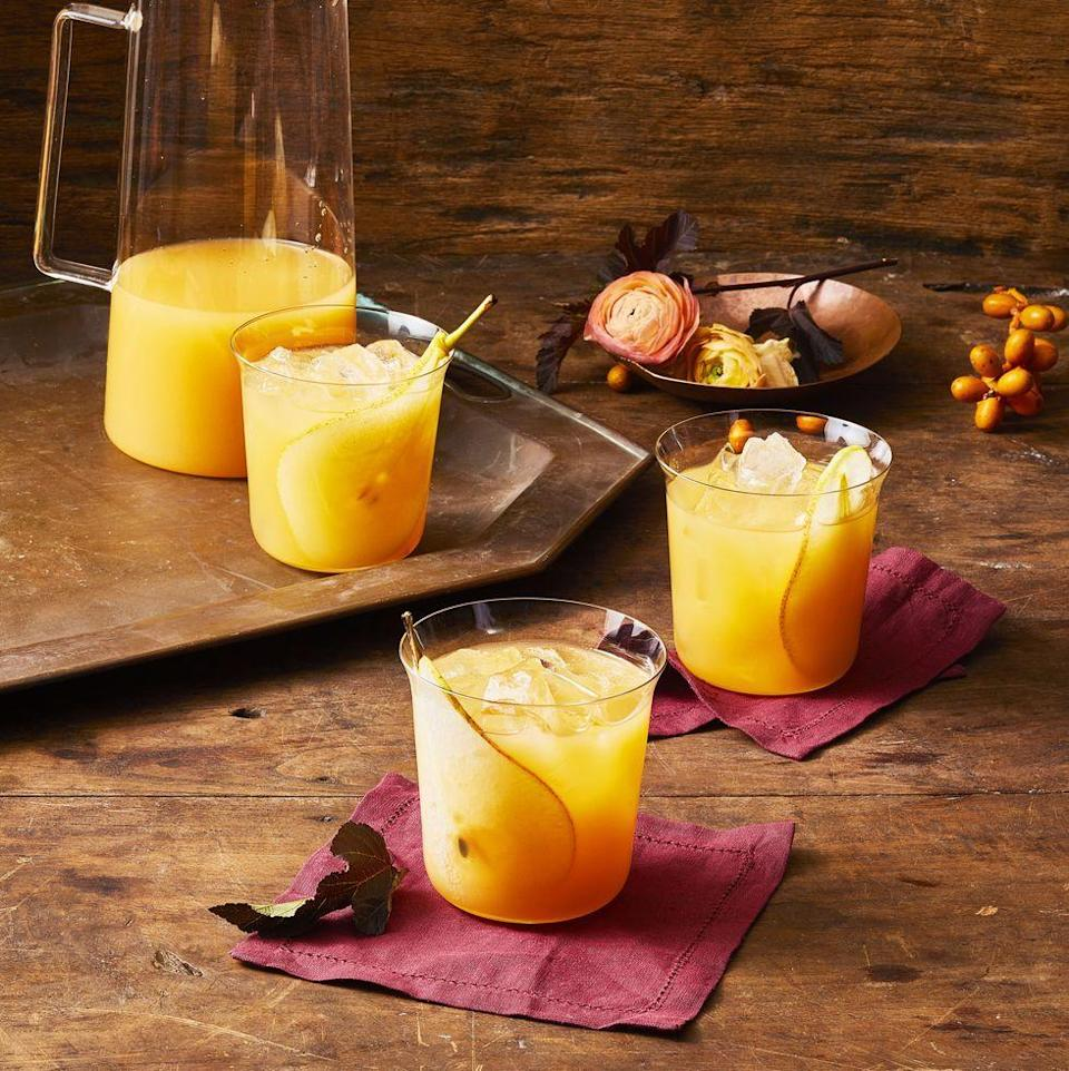 """<p>The pear nectar in this rum cocktail gives the drink an unexpectedly fruity taste.</p><p><em><a href=""""https://www.goodhousekeeping.com/food-recipes/party-ideas/a29417605/fall-punch-recipe/"""" rel=""""nofollow noopener"""" target=""""_blank"""" data-ylk=""""slk:Get the recipe for Fall Punch »"""" class=""""link rapid-noclick-resp"""">Get the recipe for Fall Punch »</a></em></p>"""