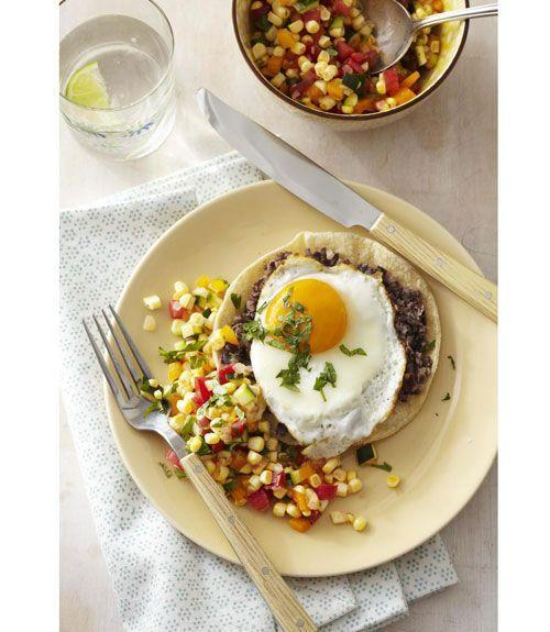 """<p>Full of finely chopped veggies and protein, this southwest-inspired recipe is low in fat and high in taste.</p><p><a href=""""https://www.goodhousekeeping.com/food-recipes/a11158/tostada-stacks-recipe-ghk0811/"""" rel=""""nofollow noopener"""" target=""""_blank"""" data-ylk=""""slk:Get the recipe for Tostada Stacks »"""" class=""""link rapid-noclick-resp""""><em>Get the recipe for Tostada Stacks »</em></a></p>"""