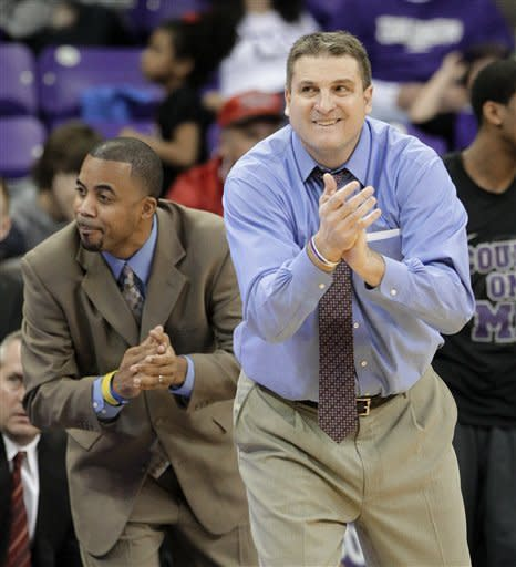 TCU head coach Jim Christian, front, and assistant coach Reggie Brown, left, cheer their team from the bench late in the second half of an NCAA college basketball game against UNLV Tuesday, Feb. 14, 2012, in Fort Worth, Texas. TCU defeated UNLV 102-97. (AP Photo/Tony Gutierrez)