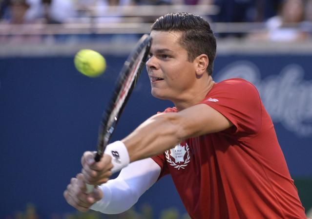 Milos Raonic, of Canada, retuns to Feliciano Lopez, of Spain at the Rogers Cup tennis tournament, Friday, Aug. 8, 2014 in Toronto. (AP Photo/The Canadian Press, Nathan Denette)