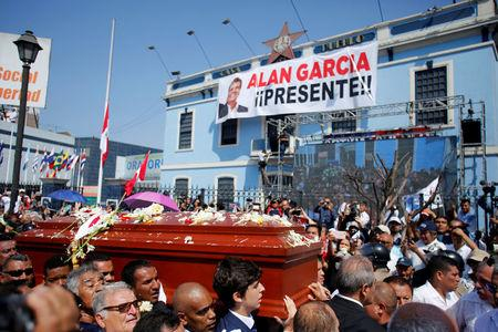 Friends and family carry the coffin with the remains of Peru's former President Alan Garcia during the last of three days of national mourning declared by President Martin Vizcarra, in Lima