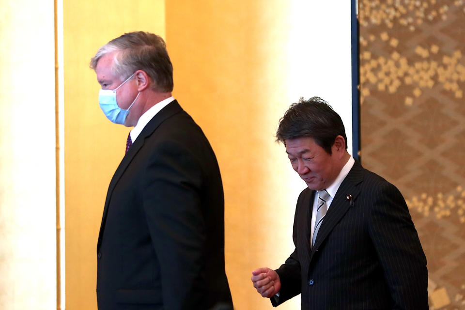 U.S. Deputy Secretary of State Stephen Biegun, left, and Japan's Foreign Minister Toshimitsu Motegi arrive to attend their bilateral meeting in Tokyo Friday, July 10, 2020. (Behrouz Mehri/Pool Photo via AP)