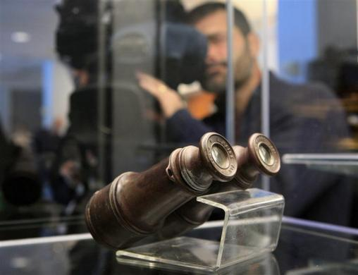 A pair of binoculars recovered from the RMS Titanic is on display during the Titanic Auction preview by Guernsey's Auction House in New York, January 5, 2012. The biggest collection of Titanic artifacts is to be sold off as a single lot in an auction timed for the 100th anniversary in April of the sinking of the famed ocean liner.