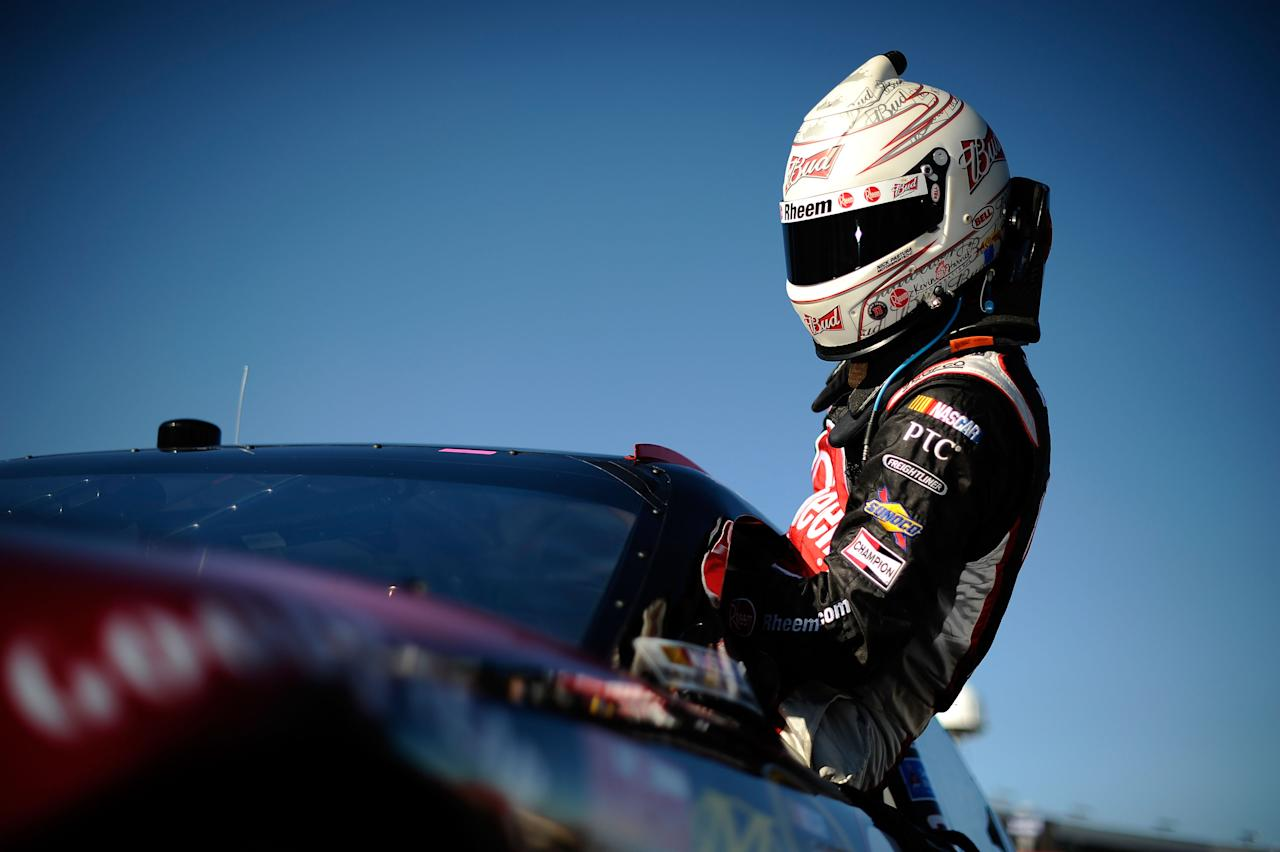 FORT WORTH, TX - NOVEMBER 04:  Kevin Harvick, driver of the #29 Rheem Chevrolet, climbs from his car after qualifying for the NASCAR Sprint Cup Series AAA Texas 500 at Texas Motor Speedway on November 4, 2011 in Fort Worth, Texas.  (Photo by Jared C. Tilton/Getty Images for NASCAR)