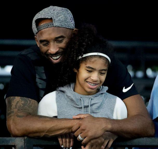 PHOTO: In this file photo taken on July 26, 2018, retired NBA star Kobe Bryant and his daughter Gianna watch during the U.S. national championships swimming meet in Irvine, California. (Chris Carlson/AP)