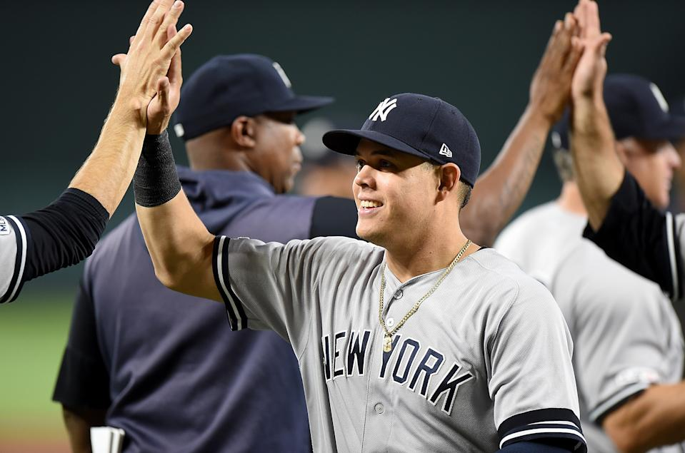 BALTIMORE, MD - AUGUST 07:  Gio Urshela #29 of the New York Yankees celebrates with teammates after a 14-2 victory against the Baltimore Orioles at Oriole Park at Camden Yards on August 7, 2019 in Baltimore, Maryland.  (Photo by Greg Fiume/Getty Images)