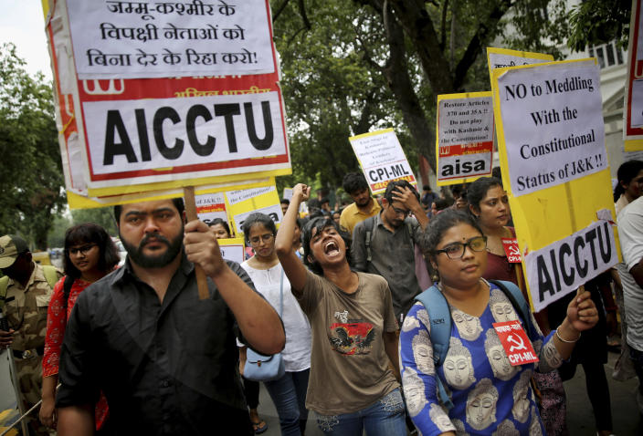 Indian activists and others shout slogans during a protest against Indian government revoking Kashmir's special constitutional status in New Delhi, India, Wednesday, Aug. 7, 2019. India's Hindu nationalist-led government has used a presidential order to revoke the special constitutional status of Muslim-majority Jammu and Kashmir state. It also had a bill passed to downgrade Jammu and Kashmir into a union territory instead of a state and turn a third region of the state, Ladakh, into a separate union territory. (AP Photo/Altaf Qadri)